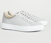 Sneaker mit Perlenverzierung Grau